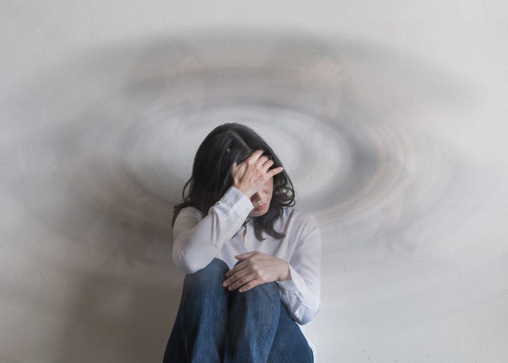 Vertigo illness with dizziness in woman patient with spinning movement inside head, benign paroxysmal positional vertigo (BPPV), migraine, heachache,